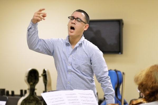 Conductor Yunior Lopez leads a Young Artists Orchestra rehearsal at the Adelson Clinic at 3661 Maryland Parkway in Las Vegas on Friday, Jan. 15, 2016. Bill Hughes/Las Vegas Review-Journal
