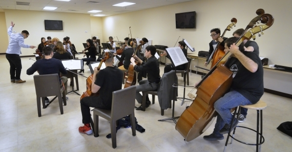 Yunior Lopez, left, conducts during a Young Artists Orchestra rehearsal at the Adelson Clinic at 3661 Maryland Parkway in Las Vegas on Friday, Jan. 15, 2016. Bill Hughes/Las Vegas Review-Journal