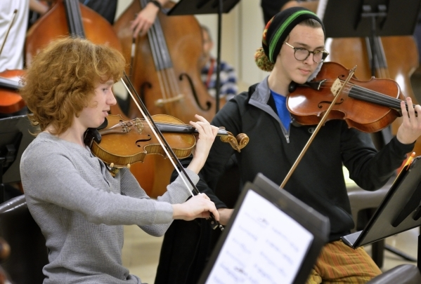 Yestyn Griffith, left, and Drake Manzanares perform during a Young Artists Orchestra rehearsal at the Adelson Clinic at 3661 Maryland Parkway in Las Vegas on Friday, Jan. 15, 2016. Bill Hughes/Las ...