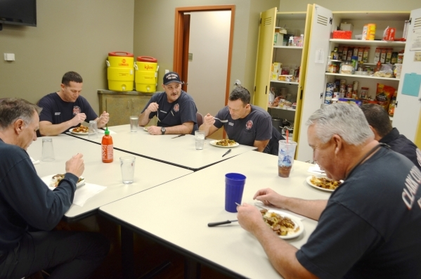 Aaron Smith shares a story with his crew in Brigade A at Clark County Fire Department Station 65 Jan. 8. Ginger Meurer/Special to View