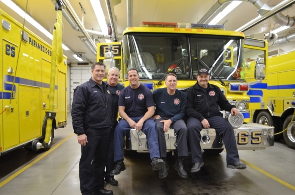 The crew at Clark County Fire Department Station 65, from left, Capt. Tony Tanara, Rick Szczepanek, Anthony Spilotro, Mike Johnson and Aaron Smith gather after dinner Jan. 8. Ginger Meurer/Special ...
