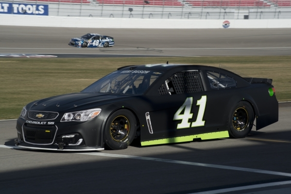 Kurt Busch (41) pulls his car onto the track as Jimmie Johnson (48) passes by during NASCAR and Goodyear tire testing at the Las Vegas Motor Speedway on Wednesday, Jan. 13, 2016. Daniel Clark/Las  ...
