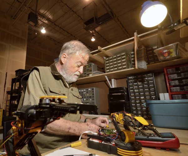 Mike Clark works on coming up with a better way to control a robot arm at the Syn Shop at 1075 American Pacific Drive in Henderson on Wednesday, Jan. 13, 2016. Bill Hughes/Las Vegas Review-Journal
