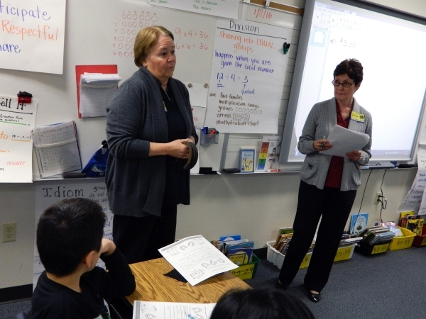 Bank of Nevada employees Daline Januik, left, and Kathy Taylor teach third-graders at McCaw Elementary School how to be money savvy Jan. 11. Cassandra Keenan/View