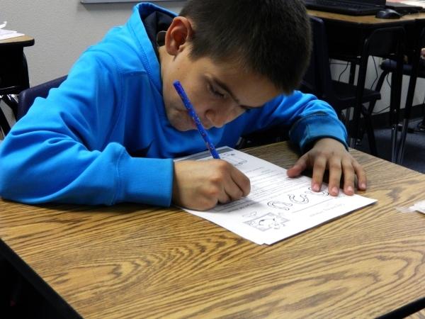 Third-grader Juan Alcala participates in a financial literacy class Jan. 11 at McCaw Elementary School. Cassandra Keenan/View