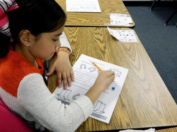Third-grader Paulina Vallejo participates in a financial literacy class Jan. 11 at McCaw Elementary School. Cassandra Keenan/View