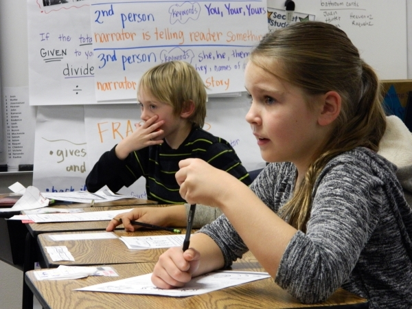 Third-graders Adam Richards, left, and Mackenzie O'Connell participate in a financial literacy class Jan. 11 led by Bank of Nevada employees Daline Januik and Kathy Taylor at McCaw Elementar ...