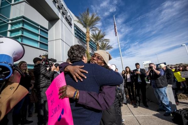 Actor Mark Ruffalo hugs Dimara Haymon, a SolarCity employee, during a solar energy rally at the PUC offices in Las Vegas on Wednesday, Jan. 13, 2016. Joshua Dahl/Las Vegas Review-Journal.