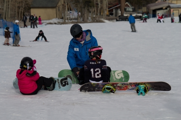 Snowboarders learn to attach their boards prior to a session at Lee Canyon Ski and Snowboard Resort. January is Learn to Ski & Snowboard Month. BEYOND VEGAS/COURTESY PHOTO