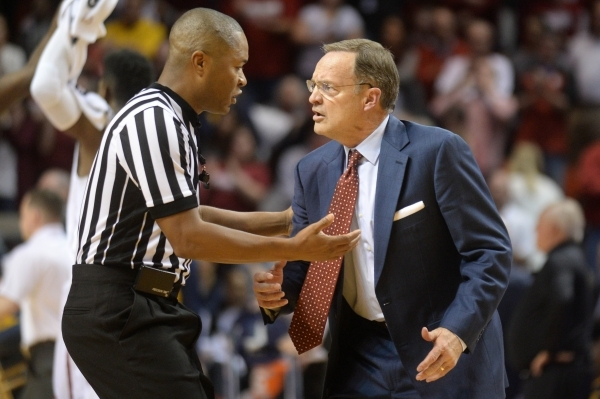 Jan 16, 2016; Norman, OK, USA; Oklahoma Sooners head coach Lon Kruger discusses a call with an official during action against the West Virginia Mountaineers during the second half at Lloyd Noble C ...