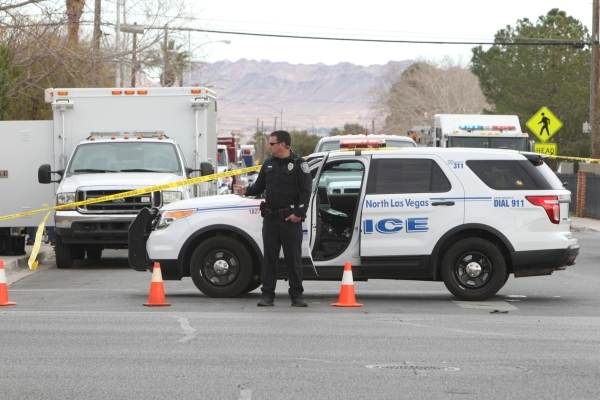 North Las Vegas police work near Civic Center Drive and Carey Avenue, where homes are being evacuated after reports of a man making threats on Wednesday, Jan. 13, 2016. Bizuayehu Tesfaye/Las Vegas ...
