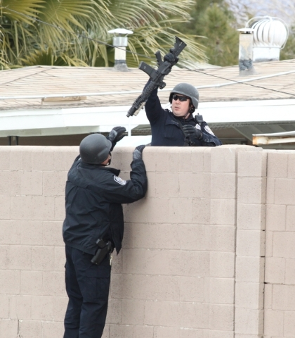 North Las Vegas police are seen at the 2600 block of St. George Street, near Carey Avenue and Civic Center where a man was making threats and locked himself inside a home, on Wednesday, Jan. 13, 2 ...