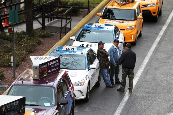 Drivers wait outside of their taxi cabs outside of New York-New York casino-hotel Wednesday, Jan. 13, 2016, in Las Vegas. Erik Verduzco/Las Vegas Review-Journal Follow @Erik_Verduzco