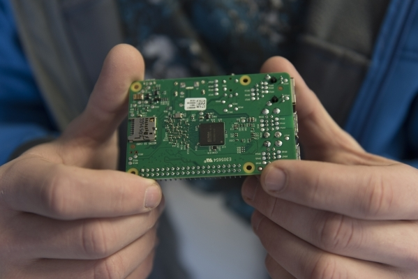 Kyle Kimsey holds a Raspberry Pi 2 chip that he plans to desolder and install into one of his drones in his workspace at his Las Vegas home Thursday, Jan. 14, 2016. Kimsey is the winner of the reg ...