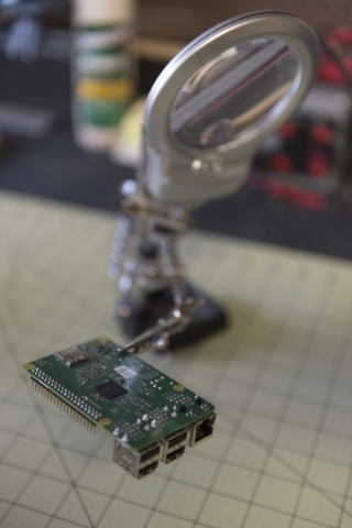 A Raspberry Pi 2 chip that will be desoldered and installed into a drone sits on Kyle Kimsey's workbench at his Las Vegas home Thursday, Jan. 14, 2016. Kimsey is the winner of the regional r ...