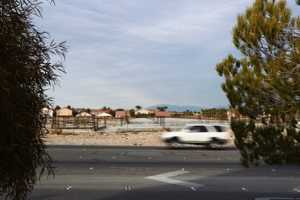An SUV drives past construction for The Mercer, a 175-unit  apartment complex being built by Storybook Homes, at Tropicana Avenue and Grand Canyon Drive, Las Vegas on Wednesday, Jan. 13, 2016. The ...