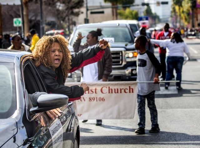 Lanice Rodgers leans out of a car while participating in the Martin Luther King parade on 4th Street in Downtown Las Vegas on Monday, Jan. 2016. Jeff Scheid/Las Vegas Review-Journal Follow @jlscheid