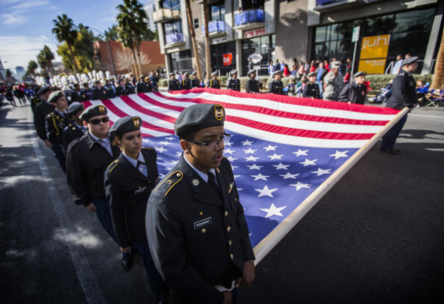 Members of the Cheyenne High School Desert Shield JROTC carry the American flag during the  Martin Luther King parade on 4th Street in Downtown Las Vegas on Monday, Jan. 2016. Jeff Scheid/Las Vega ...