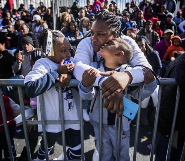 Nasheta Leslie, center,  watches the Martin Luther King parade,  Monday, Jan. 2016, on 4th Street in Downtown Las Vegas with her daughter Londyn, left, and son Sherrod. Jeff Scheid/Las Vegas Revie ...