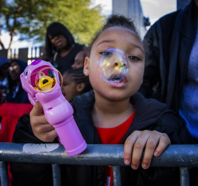 India Hammonds, 5, blows a bubble during the  Martin Luther King parade on 4th Street in Downtown Las Vegas on Monday, Jan. 2016. Jeff Scheid/Las Vegas Review-Journal Follow @jlscheid