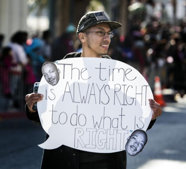 Robert Raya carries a sign while walking in the Martin Luther King parade on 4th Street in Downtown Las Vegas on Monday, Jan. 2016. Jeff Scheid/Las Vegas Review-Journal Follow @jlscheid