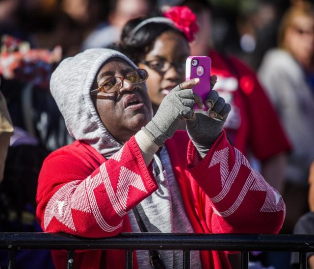 Sharon Burris takes a photo during the  Martin Luther King parade on 4th Street in Downtown Las Vegas on Monday, Jan. 2016. Jeff Scheid/Las Vegas Review-Journal Follow @jlscheid