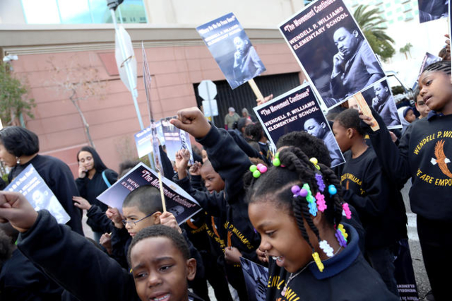 Children from Wendell P. Williams Elementary School wait for the Martin Luther King Jr. Parade to start in Downtown Las Vegas Monday, Jan. 18, 2016. Rachel Aston/Las Vegas Review-Journal Follow@ro ...