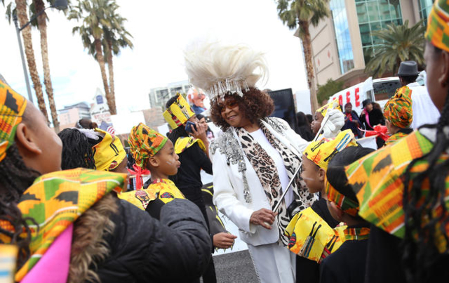 Mrs. Graves, center, talks to her class from 100 Academy while they wait for the Martin Luther King Jr. Parade to start in Downtown Las Vegas Monday, Jan. 18, 2016. Rachel Aston/Las Vegas Review-J ...