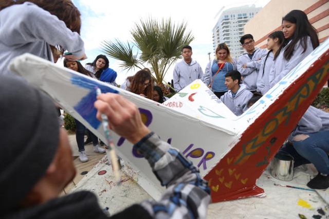 Anthony Martinez paints a part of the float for the Nevada Desert Experience while they wait for the Martin Luther King Jr. Parade to start in Downtown Las Vegas Monday, Jan. 18, 2016. Rachel Asto ...