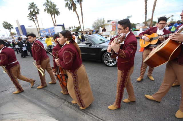 Mariachi Los Dorados walk toward their line for the parade while they wait for the Martin Luther King Jr. Parade to start in Downtown Las Vegas Monday, Jan. 18, 2016. Rachel Aston/Las Vegas Review ...