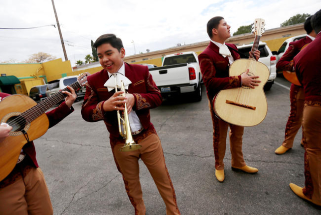 Heber Juarez, with the trumpet, and Abraham Fernandez with the bass, of Mariachi Los Dorados, wait for the Martin Luther King Jr. Parade to start in Downtown Las Vegas Monday, Jan. 18, 2016. Rache ...