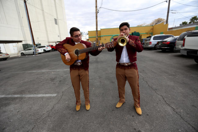 Jayson Estrada, on guitar, and Heber Juarez, on trumpet, of Mariachi Los Dorados, play while they wait for the Martin Luther King Jr. Parade to start in Downtown Las Vegas Monday, Jan. 18, 2016. R ...