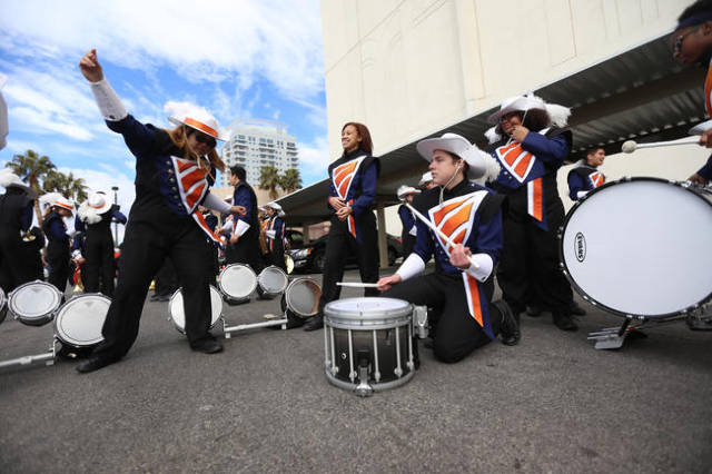 Cathalina Makekau, left, Arianna Marentic, Parker Levanger and Aries Black of Legacy High School's marching band practice and dance while they wait for the Martin Luther King Jr. Parade to s ...