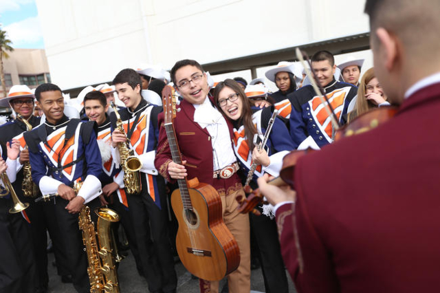 Jeyson Estrada hugs Jessica Qintero after he and Mariachi Los Dorados played her favorite song while they wait for the Martin Luther King Jr. Parade to start in Downtown Las Vegas Monday, Jan. 18, ...