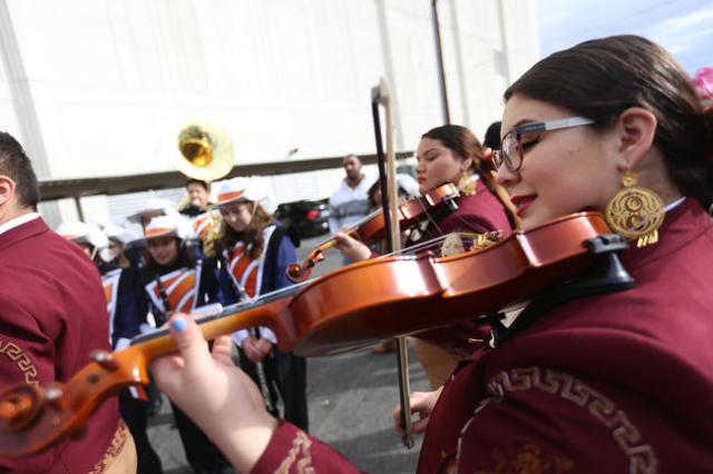 Rachel Garibay of Mariachi Los Dorados plays violin while she waits for the Martin Luther King Jr. Parade to start in Downtown Las Vegas Monday, Jan. 18, 2016. Rachel Aston/Las Vegas Review-Journa ...