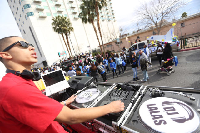 D.J. James Lalas plays music while participants of the parade wait for the Martin Luther King Jr. Parade to start in Downtown Las Vegas Monday, Jan. 18, 2016. Rachel Aston/Las Vegas Review-Journal ...