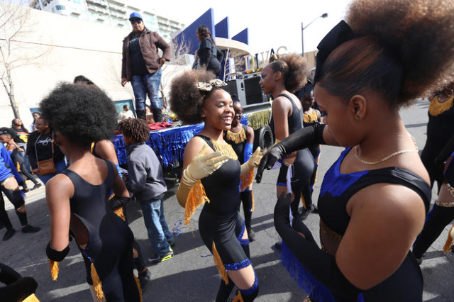 K'Triana Jackson and Destini Davis of the Lovely Divas dance team dance while they wait for the Martin Luther King Jr. Parade to start in Downtown Las Vegas Monday, Jan. 18, 2016. Rachel Ast ...