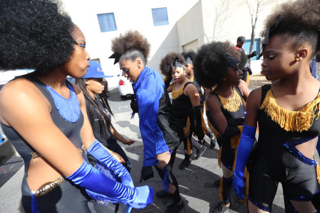 Members of the Lovely Divas dance team dance while they wait for the Martin Luther King Jr. Parade to start in Downtown Las Vegas Monday, Jan. 18, 2016. Rachel Aston/Las Vegas Review-Journal Follo ...