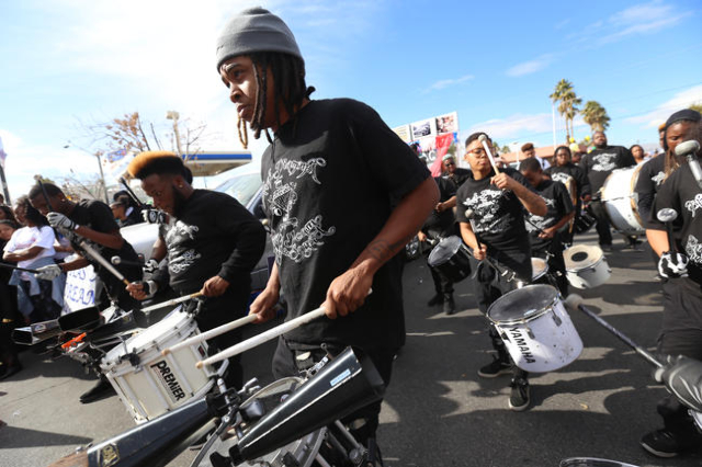The drum core of the Black Diamond Drill Team and Drum Squad practice while they wait for the Martin Luther King Jr. Parade to start in Downtown Las Vegas Monday, Jan. 18, 2016. Rachel Aston/Las V ...