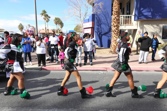 The drill team of the Black Diamond Drill Team and Drum Squad walk towards their start in the Martin Luther King Jr. Parade in Downtown Las Vegas Monday, Jan. 18, 2016. Rachel Aston/Las Vegas Revi ...