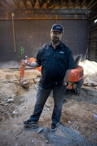 Lance Johns explains how renovations for Atomic Kitchen will work inside the garage immediately next door to Atomic Liquors in Downtown Las Vegas on Friday, Jan. 15, 2016. His project is experienc ...