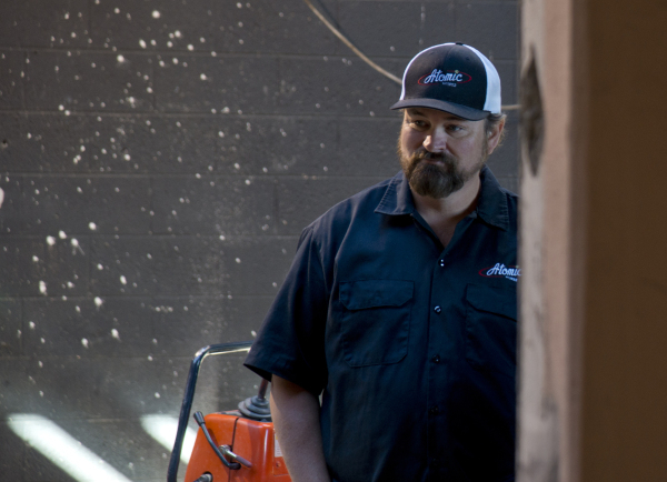 Lance Johns looks over renovations for Atomic Kitchen, inside the garage immediately next door to Atomic Liquors, in Downtown Las Vegas on Friday, Jan. 15, 2016. His project is experiencing pushba ...