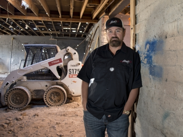 Lance Johns poses for a portrait inside the garage he is currently renovating into Atomic Kitchen, immediately next door to Atomic Liquors, in Downtown Las Vegas on Friday, Jan. 15, 2016. His proj ...