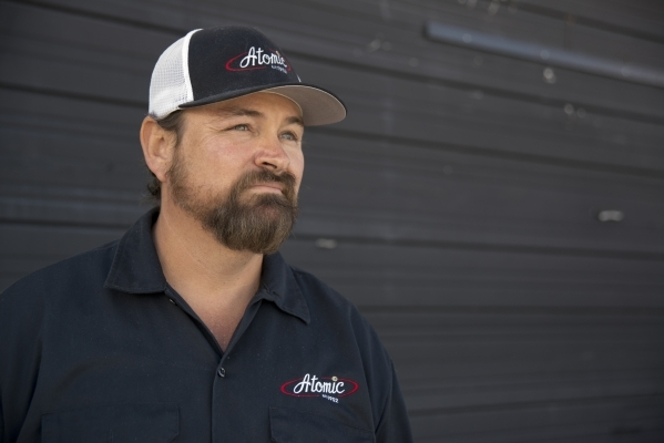 Lance Johns poses for a portrait outside the garage he is currently renovating into Atomic Kitchen, immediately next door to Atomic Liquors, in Downtown Las Vegas on Friday, Jan. 15, 2016. His pro ...