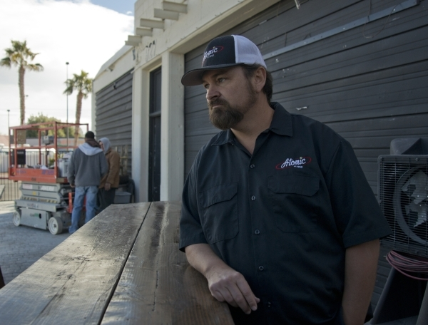 Lance Johns stands outside the garage he is currently renovating into Atomic Kitchen, immediately next door to Atomic Liquors, in Downtown Las Vegas on Friday, Jan. 15, 2016. His project is experi ...
