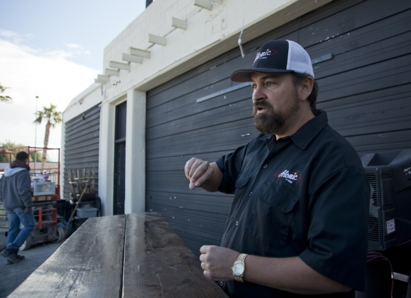 Lance Johns explains how renovations for Atomic Kitchen will work outside the garage immediately next door to Atomic Liquors, in Downtown Las Vegas on Friday, Jan. 15, 2016. His project is experie ...