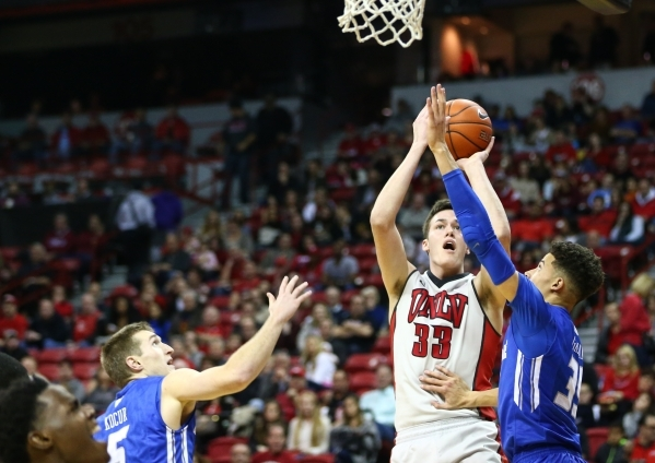UNLV forward Stephen Zimmerman Jr. (33) goes up for a shot against Air Force guard Zach Kocur (5) and Air Force forward Hayden Graham (35) during a basketball game at the Thomas & Mack Center  ...