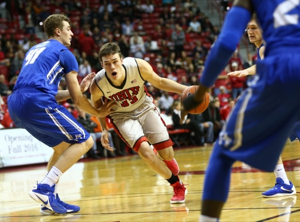 UNLV forward Stephen Zimmerman Jr. (33) drives against Air Force center Zach Moer (41) during a basketball at the Thomas & Mack Center in Las Vegas on Saturday, Jan. 16, 2016. Chase Stevens/La ...