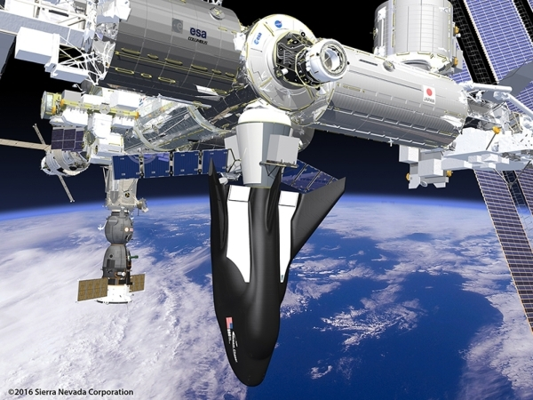 Sierra Nevada Corp.'s Dream Chaser spacecraft and cargo module attached to the Internatinal Space Station. (Courtesy Sierra Nevada Corp.)