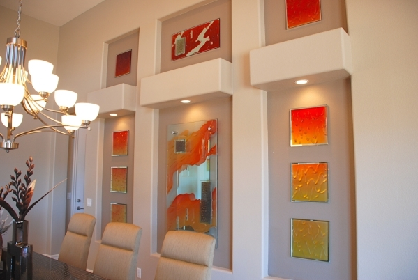 These carved and colored glass art pieces have bevels as accents and add a look of sophistication to the room. COURTESY OF GLASSIC ART